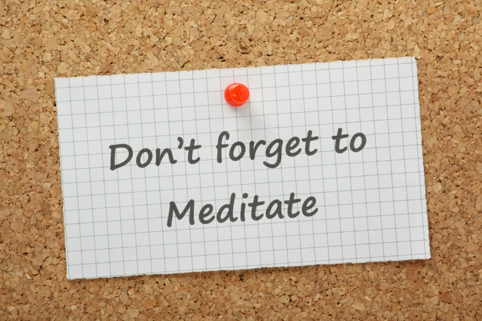 Don't Forget to Meditate reminder on a cork notice board